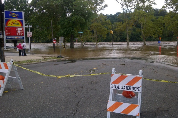 Flood waters creeped up towards a gas station in northwest Philadelphia Sunday. (Brian Hickey/For NewsWorks)