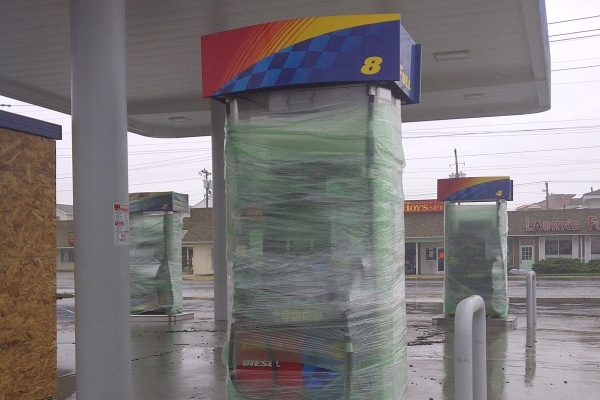 Some gas pumps in New Jersey were wrapped with plastic for proection from the hurricane. (Tom MacDonald/For NewsWorks)