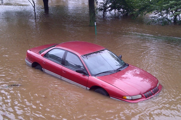 A car, stuck in flood water, was left abandoned without tages on East River Road. (Brian Hickey/For NewsWorks)