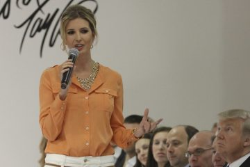 In this Wednesday, March 28 2012, file photo, Ivanka Trump wears an outfit she designed as she speaks to the audience prior to the presentation of her Ready-To-Wear Collection at the Lord & Taylor flagship store in New York. Trump's father, Donald, is seated to the right. Retailers are trying to figure out a way to deal with the politically charged Ivanka Trump brand, stamped on everything from shoes to pants to handbags. The products have become more polarized with President Donald Trump's rise to the White House. (AP Photo/Mary Altaffer, File)