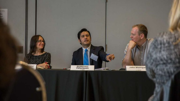 At the second annual Keystone Crossroads Urban Ideas Worth Stealing conference in Harrisburg, Guillermo Velazquez (center), chair of the Latino Business Initiative of the Pittsburgh Metropolitan Area Hispanic Chamber of Commerce, discusses immigrants starting small businesses. (Lindsay Lazarski/WHYY)