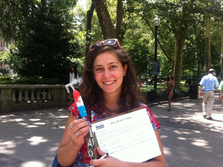 Pictured: Isabella Levy, intern for PennEnvironment. The group used a timely tactic - popsicles - to get people's attention about global warming. (Meg Frankowski/for NewsWorks)