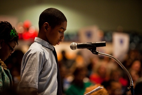 <p><p>McCloskey Elementary sixth-grader Lacroixx Brice reads a speech he wrote about why his school shouldn't be closed, citing academic acheivement among many students. (Brad Larrison/for NewsWorks)</p></p>