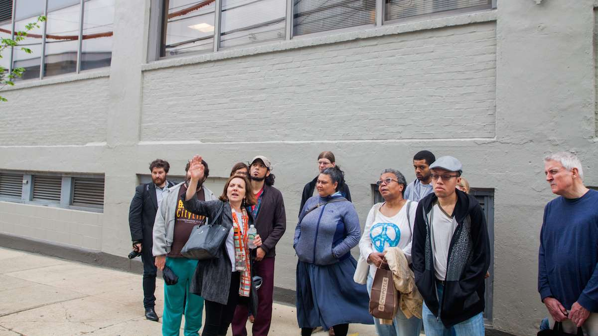 Drexel University Architect Nancy Rogo Trainer speaks to Jane's Walk participants about The Summit, a high rise student apartment building with ground floor retail space, near the terminus of Lancaster Avenue in University City.