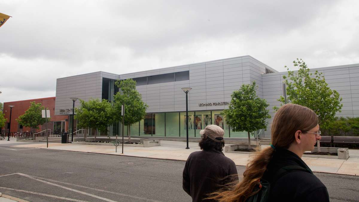 Participants in the Jane's Walk pass by Drexel University's URBN Center for Arts and Design which was opened in 2013.