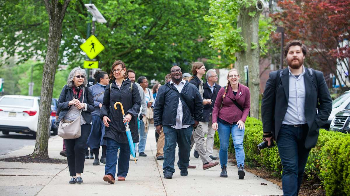 The group of participants in Friday's Jane's Walk head down Lancaster Avenue through University City.