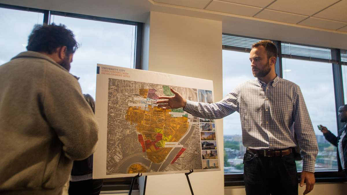 Peter Cramer of Wexford Science and Technologies goes over a map of current and proposed development in and around University City at the beginning of a Jane's Walk through the neighborhood Friday.