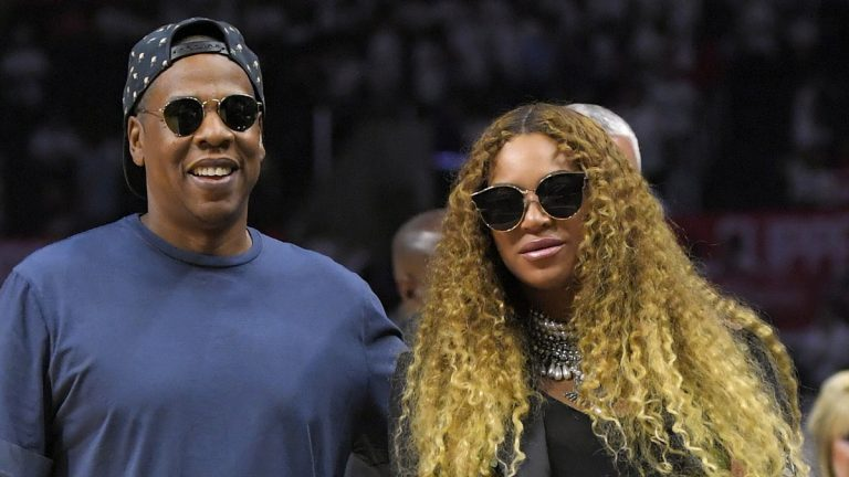Jay Z, left, and Beyoncé leave the court after Game 7 of an NBA basketball first-round playoff series between the Los Angeles Clippers and the Utah Jazz, Sunday, April 30, 2017, in Los Angeles. (AP Photo/Mark J. Terrill, file)