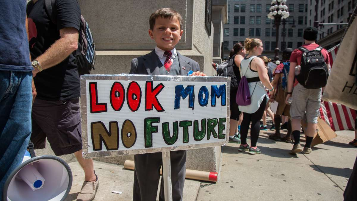 Connor Garrett, 9, protests for Bernie Sanders with his dad. They traveled from Connecticut to attend the rallies during the Democratic National Convention in Philadelphia.