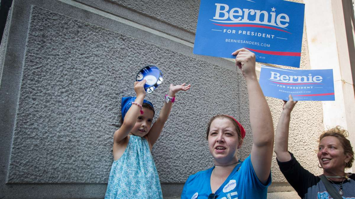 Sanders supporters Renee Bolduc, 35, and her daughter, Ava Lia, 5, chant ''This is what democracy looks ilke'' during a rally at City Hall in Philadelphia on July 25, 2016.