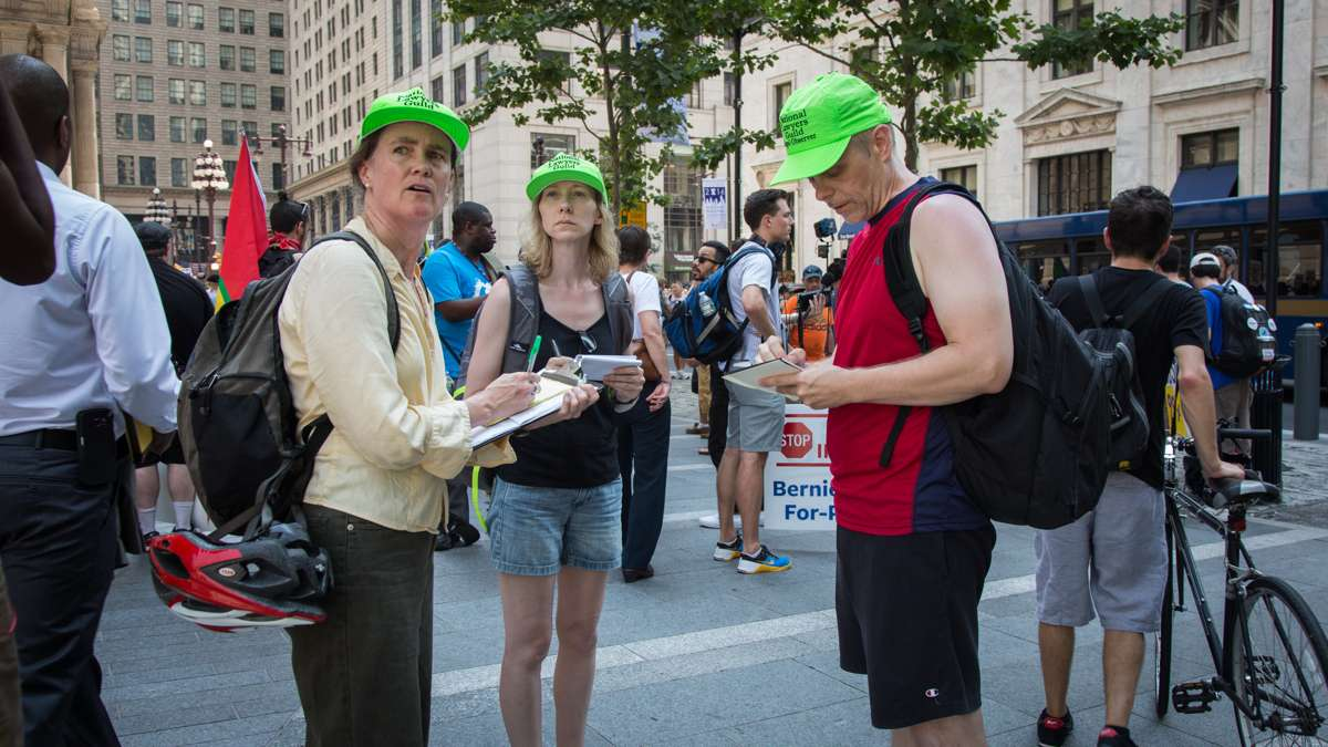 Members of the National Lawyers Guild watch the rallies taking place around City Hall to observe the interactions between protesters and police during the Democratic National Convention July 25th 2016.