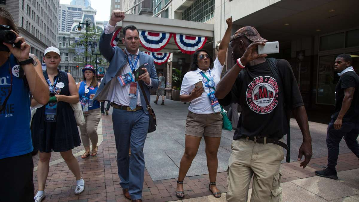 Bernie Sanders delegates happen upon Bernie supporters during a protest near City Hall in Philadelphia July 25, 2016.