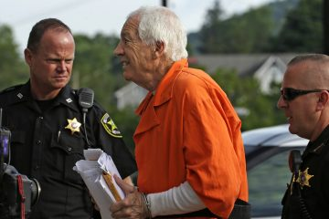 In this file photo, former Penn State University assistant football coach Jerry Sandusky, center, arrives at the Centre County Courthouse, in Bellefonte, Pa. Friday, Aug. 12, 2016. (Gene J. Puskar/AP Photo, file)