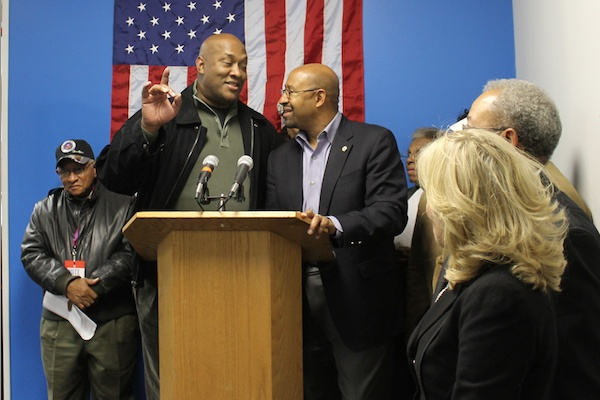 <p>&lt;p&gt;State Rep. Dwight Evans and Mayor Michael Nutter share a moment at the podium at Saturday afternoon's rally. (Matthew Grady/for NewsWorks)&lt;/p&gt;</p>