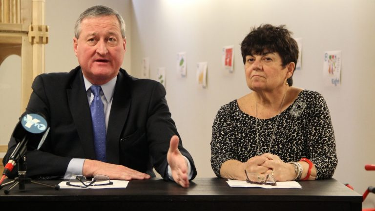 Jim Kenney speaks about his education-policy paper while retired teacher  Rachelle Nocito looks on. (Emma Lee/WHYY)