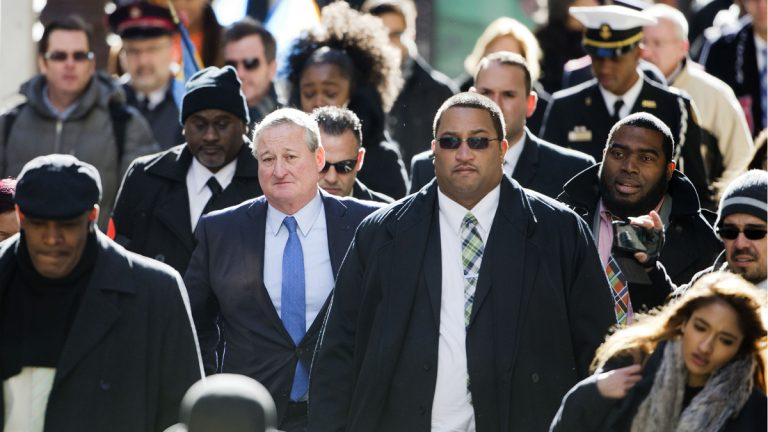 Newly sworn in Philadelphia Mayor Jim Kenney, center left, takes the sidewalk from his inauguration to City Hall Monday, Jan. 4, 2016, in Philadelphia. The 57-year-old Kenney succeeds Michael Nutter, who leaves office after two terms. Kenney served on city council for more than two decades before he was elected in November. (AP Photo/Matt Rourke)
