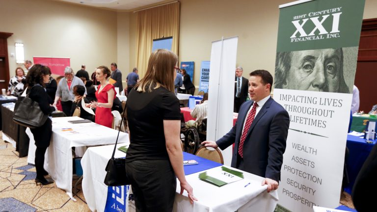 Employment recruiters and company representatives speak with job seekers at a job fair in Pittsburgh. (AP Photo/Keith Srakocic)
