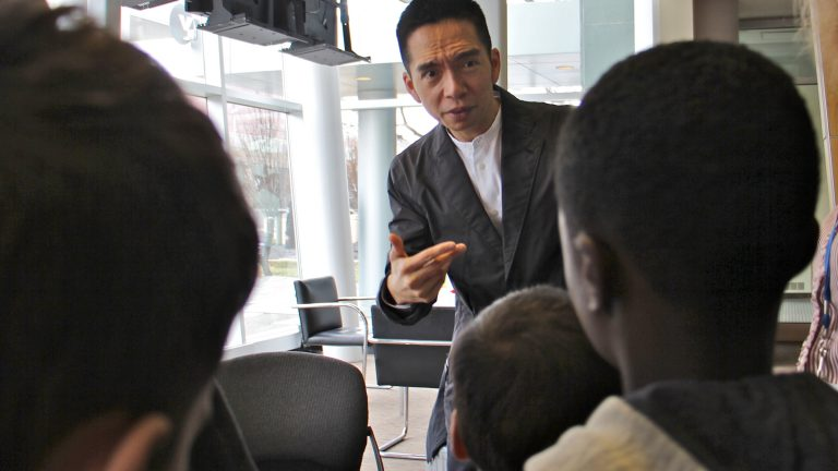 John Maeda, the global head of computational design and inclusion at web developer Automattic, speaks with a school group at WHYY studios. (Emma Lee/WHYY)