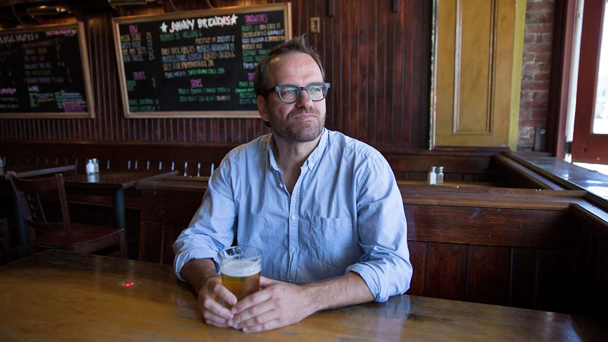 Ten years ago, William Reed (pictured) and Paul Kimport walked into a corner bar in Fishtown and walked out with a handshake agreement to buy what has become one of Philly's iconic bars, Johnny Brenda's. (Lindsay Lazarski/WHYY)