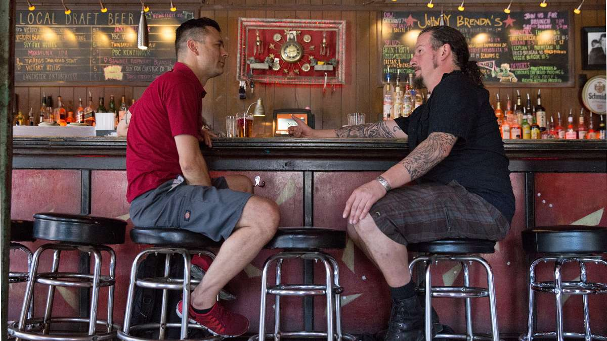 Bob Achilles (left) and Erik Boardman have a drink at Johnny Brenda's before starting their bartending shifts at another Fishtown pub. (Lindsay Lazarski/WHYY)
