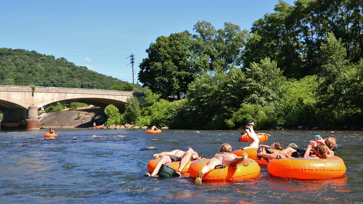 A group of tubers float down the Stoneycreek River. Bob Bridges and others who use the waterways for recreation, say it has been difficult to change people's perception about the rivers in Johnstown. (Lindsay Lazarski/WHYY)
