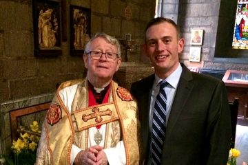 The author, right, stands with a mentor, Father Gordon Reid, at Easter. (Image courtesy of Josh Kruger)