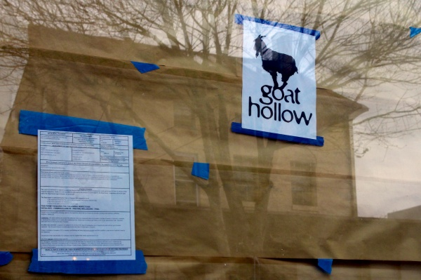 <p>A preview of the Goat Hollow Tavern's new logo is displayed near the building permit. ( Jana Shea /for NewsWorks )</p>