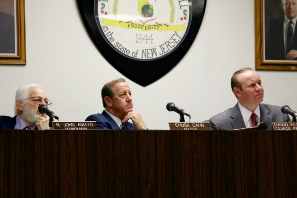 <p>Cherry Hill's Mayor Chuck Cahn, Council President David Fleisher and Councilman N. John Amato listen to public remarks on the township's new smoking ban. ( Jana Shea /for NewsWorks )</p>