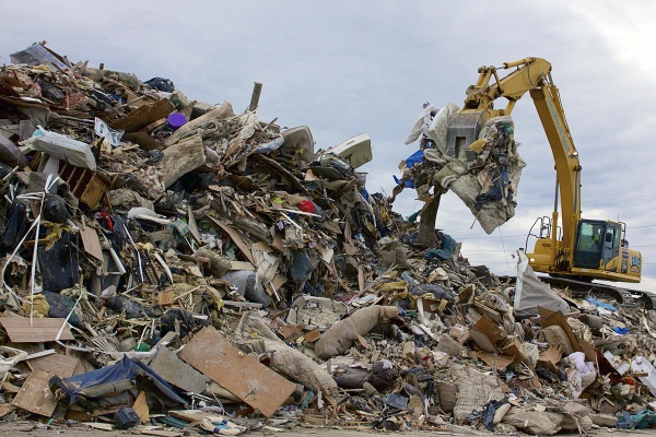 <p>On the edge of town, the remnants of people's lives forms a mountain of debris. ( Jana Shea /for NewsWorks )</p>