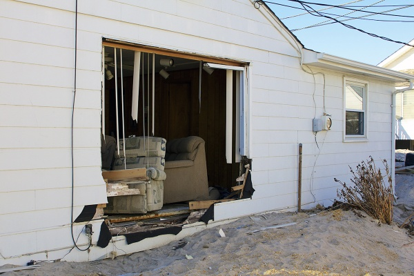 <p>Sandy left a gaping hole in the side of a home in nearby Ortley Beach. ( Jana Shea /for NewsWorks )</p>
