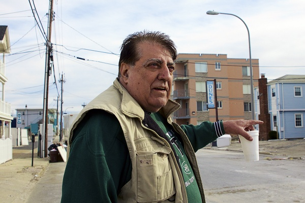 <p>Jay Mazzei remained in town through the storm.  He said he only grew worried when he watched Sandy rip the roof off the Fremont Arms across the street from his home. ( Jana Shea /for NewsWorks )</p>