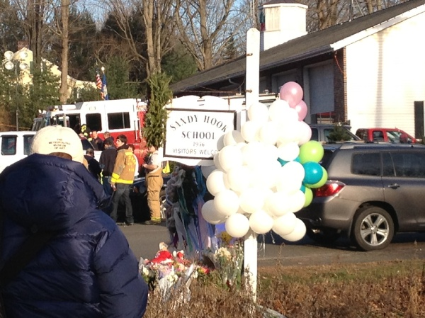 <p><p>At Sandy Hook Elementary School, Newtown residents offer flowers and balloons in remembrance of the victims. (Photo courtesy of Monika Gupta)</p></p>