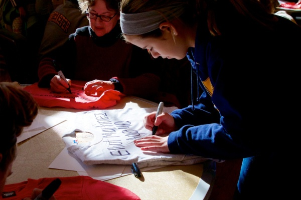 <p>Many of the volunteers hand printed the victims' names on t-shirts.  ( Jana Shea /for NewsWorks )</p>