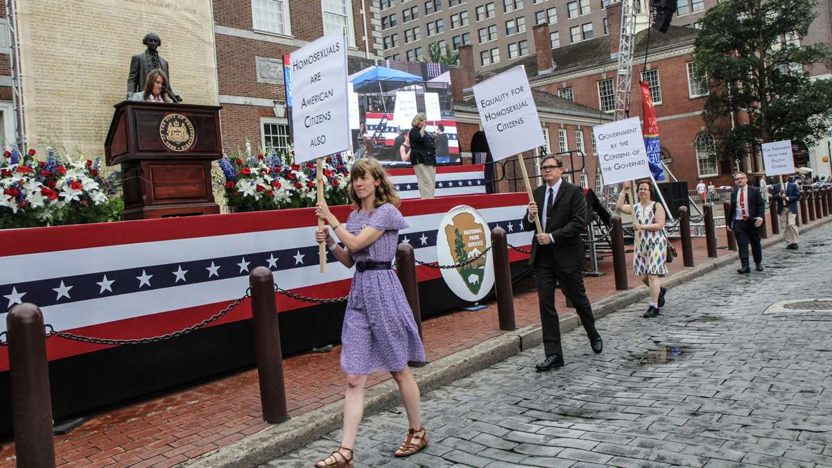 Participants reenact the 1965 picket for LGBT rights at Philadelphia's 4th of July celebration of the 50th anniversary of the LGBT civil rights movement. (Kimberly Paynter/WHYY)