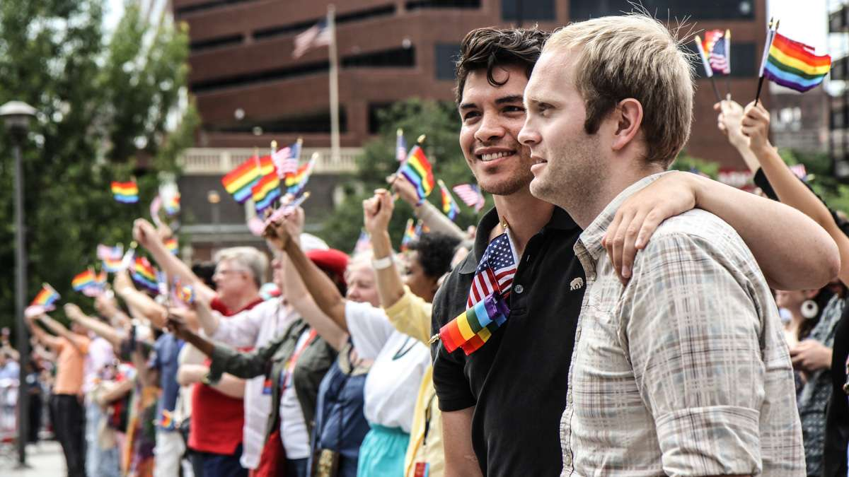 Felix Vazquez and Bryan Kerr attend Philadelphia's 4th of July celebration of the 50th anniversary of the LGBT civil rights movement. (Kimberly Paynter/WHYY)