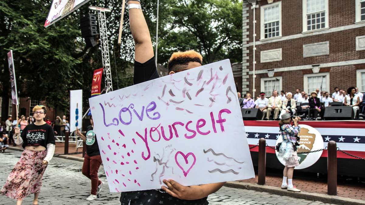 LGBT youth picket for equal rights and understanding at Philadelphia's 4th of July celebration of the 50th anniversary of the LGBT civil rights movement. (Kimberly Paynter/WHYY)