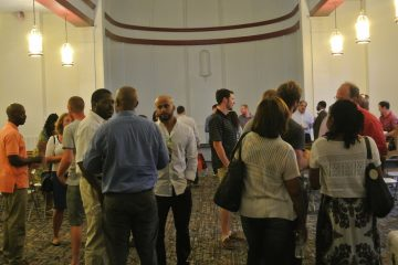 Networking at Jumpstart Germantown meeting. (Queen Muse/for NewsWorks)