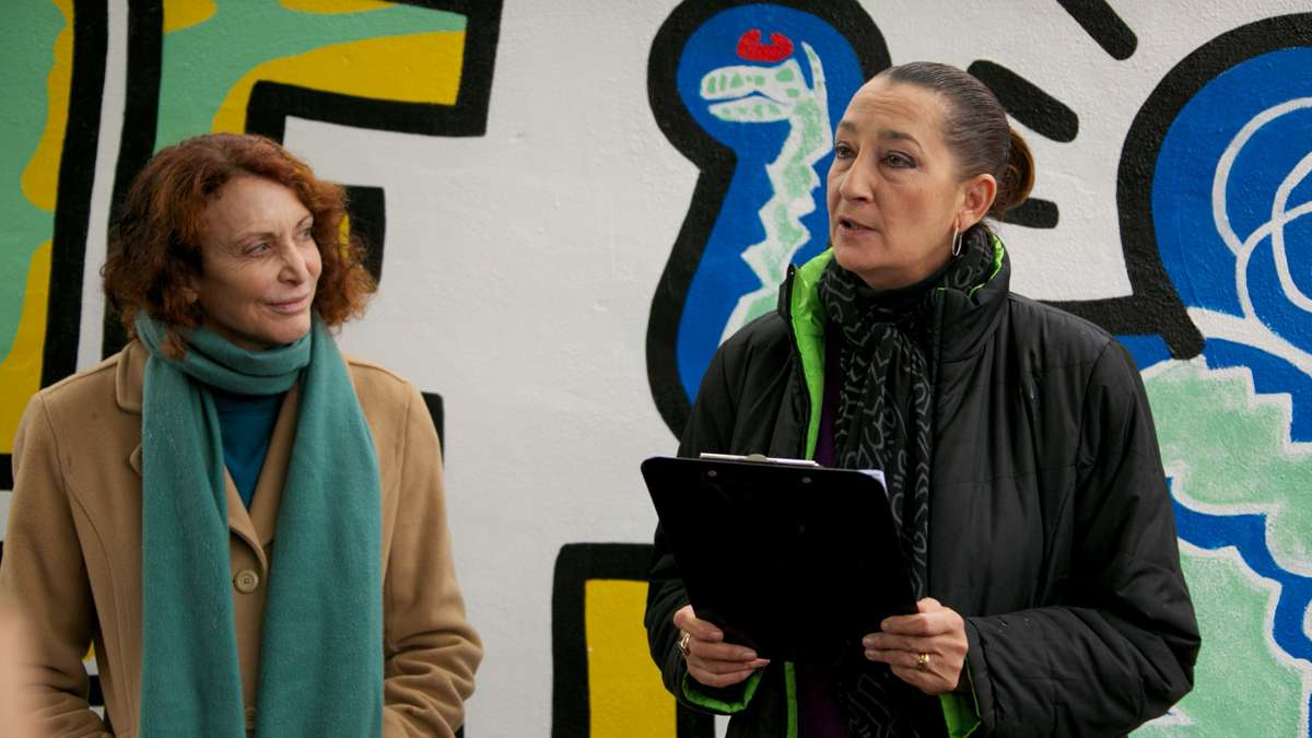 Jane Golden, Executive Director of The City of Philadelphia Mural Arts Program, celebrates the reopening with Julie Gruen, Executive Director of The Keith Haring Foundation.