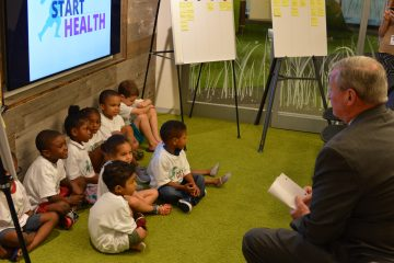 Mayor Jim Kenney speaks with children before announcing the new health initiative.