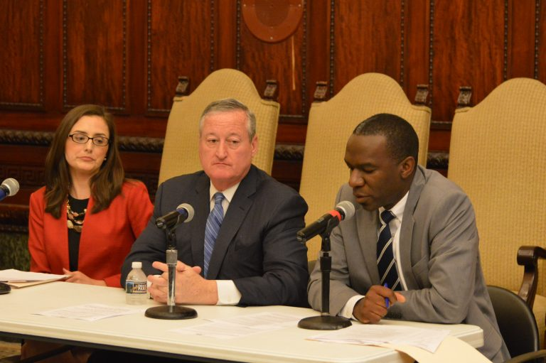Mayor Jim Kenney and  City Solicitor Sozi Pedro  Tulante (right) talk about Philadelphia's policy on unauthorized immigrants. (Tom MacDonald/WHYY)