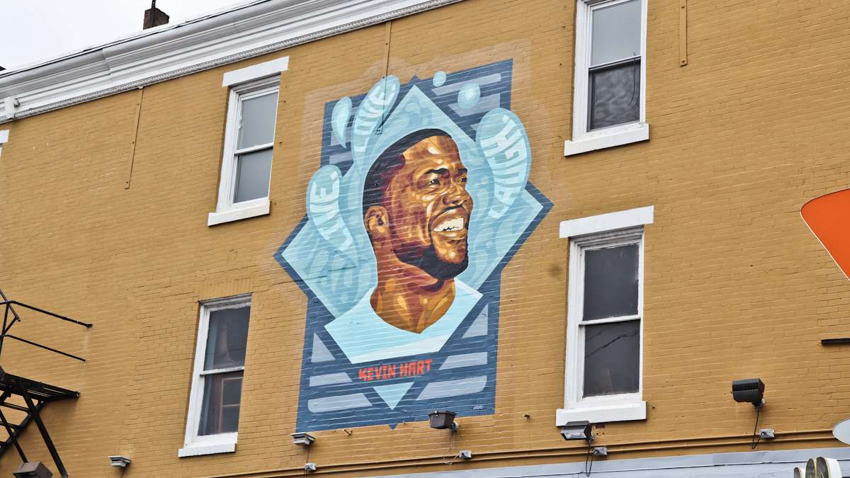 Kevin Hart fans gather to celebrate the comedian on his birthday at the site of the new mural of his likeness at Germantown Ave. and Erie Ave. in North Philadelphia.