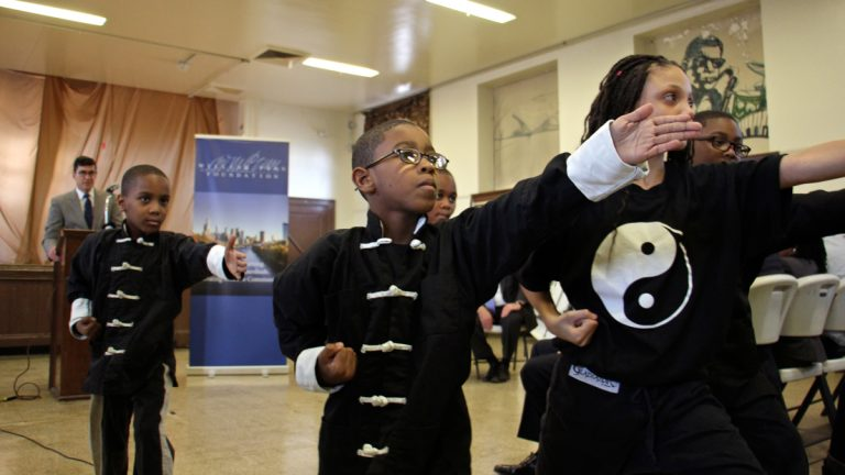 As Philadelphia managing director Michael DiBerardinis looks one, Students of Cecil B. Moore Recreation Center perform during the announcement of a $100 million grant from the William Penn Foundation to improve public spaces in Philadelphia. (Emma Lee/WHYY)