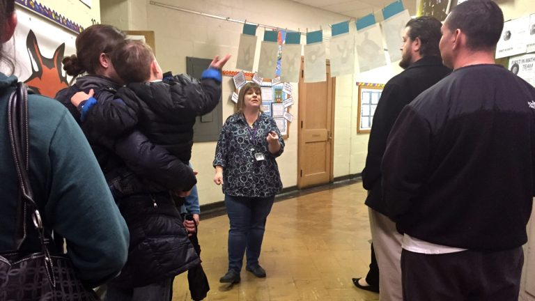 Kelly Stacey leads prospective kindergarten parents on a tour of Fox Chase school. (Avi Wolfman-Arent/WHYY)