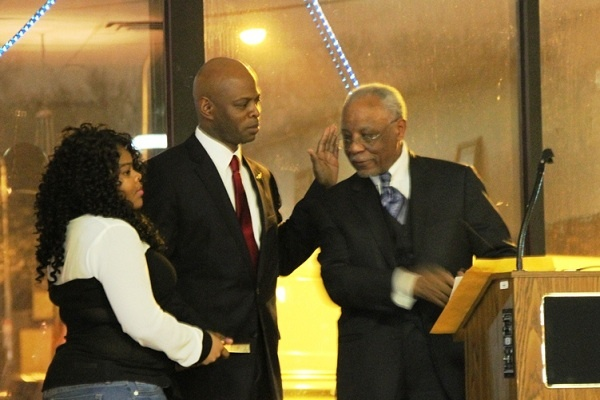 <p><p>State Rep. Stephen Kinsey's granddaughter Shakeira Holiday holds the bible as former Mayor W. Wilson Goode, Sr. ceremonially administers the Oath of Office. (Trenae V.McDuffie/for NewsWorks)</p></p>