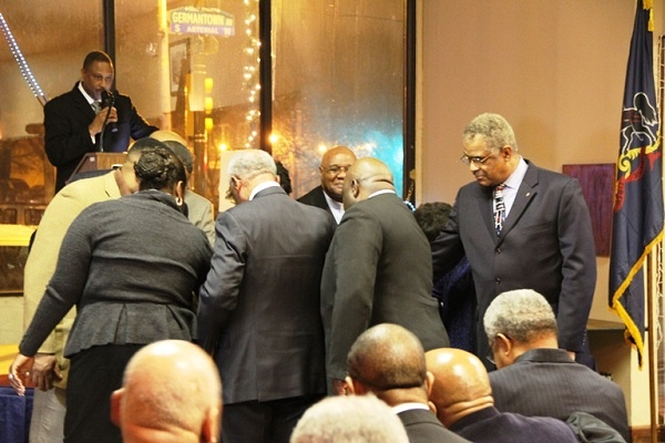 <p><p>Rev. Dr. Bruce W. Petty, Sr. leads clergy members in a circle of prayer for state. Rep. Stephen Kinsey. (TrenaeV.McDuffie/for Newsworks)</p></p>