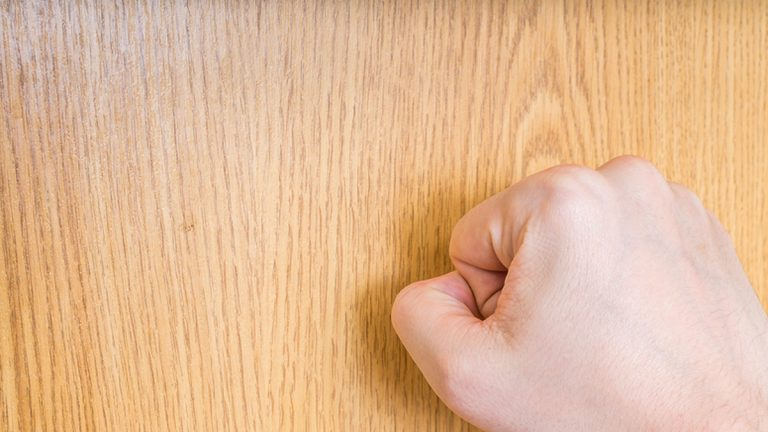 (<a href='https://www.bigstockphoto.com/image-135000383/stock-photo-man-%28the-visitor%29-is-knocking-on-closed-wooden-door'>vchal</a>/Big Stock Photo)