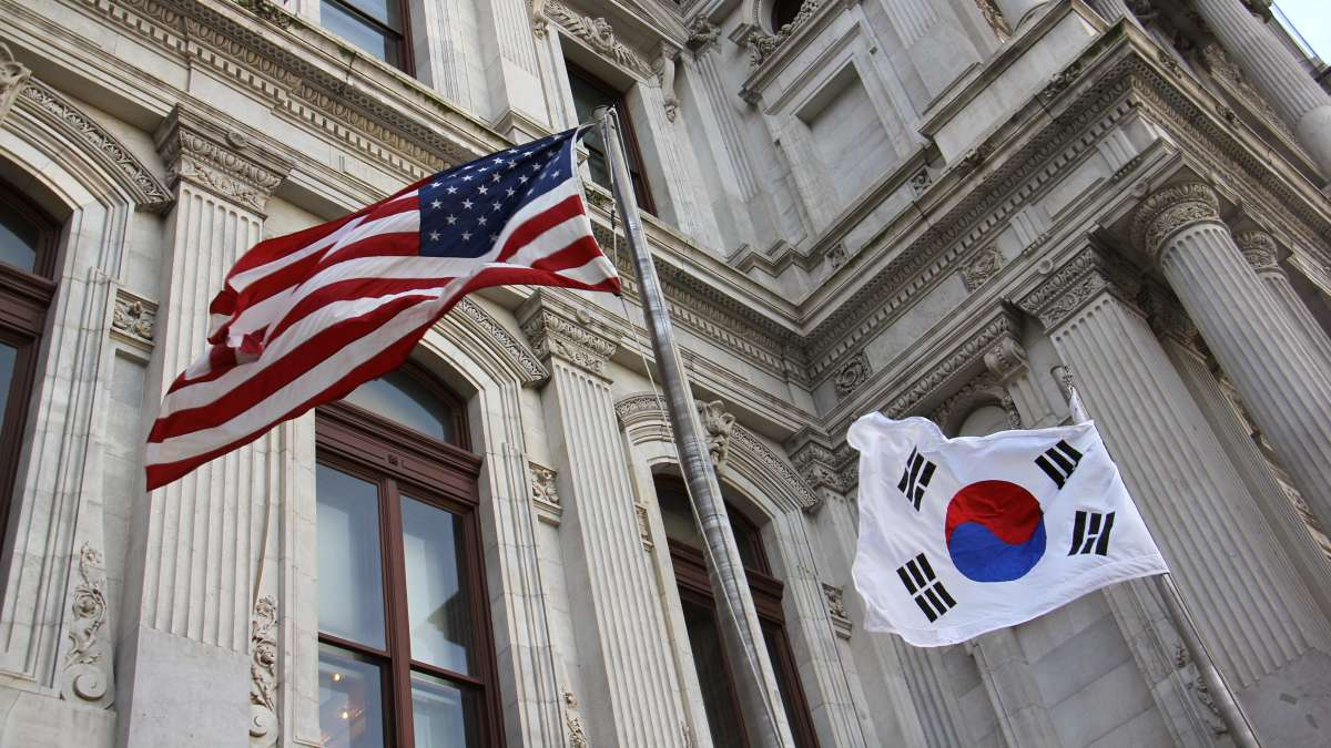 The American flag and the flag of the Republic of Korea fly side-by-side at City Hall in honor of Korean American Day.