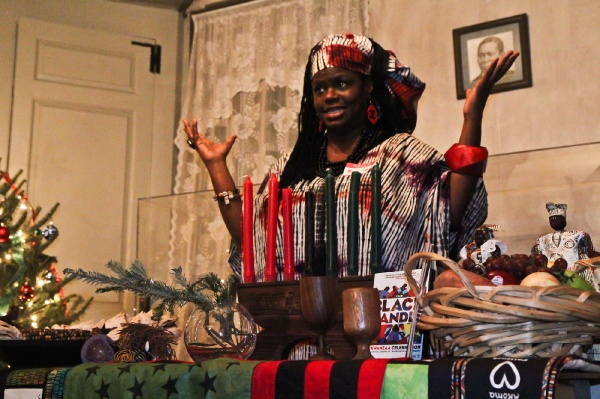 "<p><p>Saundra ""Momma Sandi"" Gilliard, president of African Storytelling group Keepers of the Culture, gives a Kwanzaa presentation at the historic Johnson House in Germantown. (Kimberly Paynter/WHYY)</p></p>"