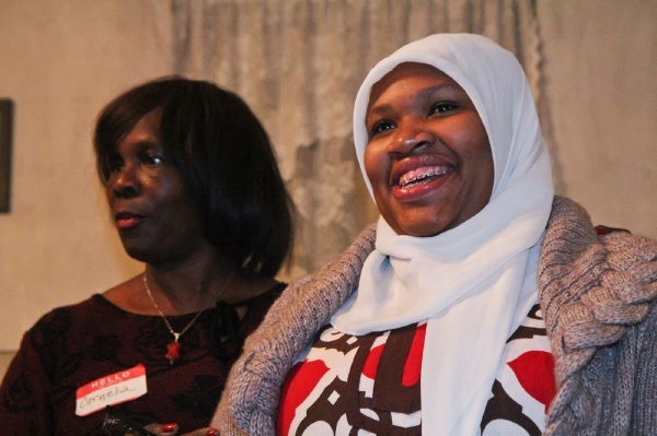 <p><p>Johnson House Executive Director Cornelia Swinson recognizes Germantown High School senior Aliyah Muhammad who designed an historic tour of the Johnson House as part of her senior internship. (Kimberly Paynter/WHYY)</p></p>