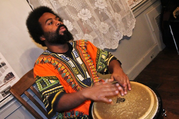 <p><p>Levi Joynes, a percussionist with Temple University's Pan-African Studies Community Education Program (PASCEP), drums at the Johnson House Kwanzaa celebration on Thursday night. (Kimberly Paynter/WHYY)</p></p>